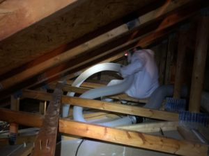 A BWS specialist performs attic cleanup and repair service at a Columbus residence.